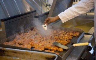 A restaurant employee cooking food