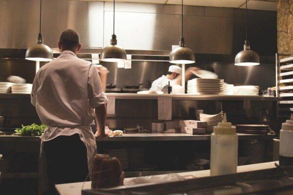 Several chefs working in a restaurant kitchen